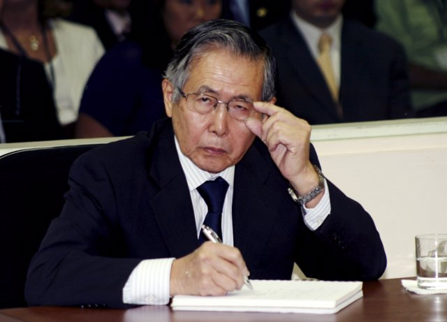 Peru's Former President Alberto Fujimori listens to the judge during the reading