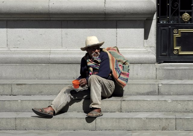 A man sits at the stairs of the city hall in La Paz, July 27, 2015. REUTERS/Davi