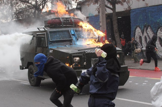 Demonstrators clash with riot police during a protest marking the 44th anniversa