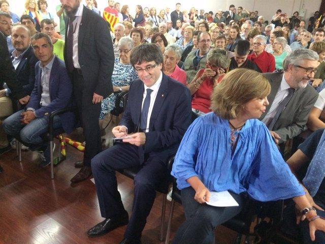 El presidente Carles Puigdemont y la consellera Meritxell Borràs