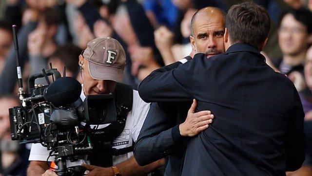 Pochettino abraza a Guardiola