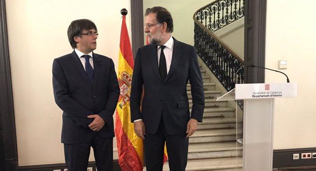 El presidente del Gobierno, Mariano Rajoy, y el del Govern, Carles Puigdemont