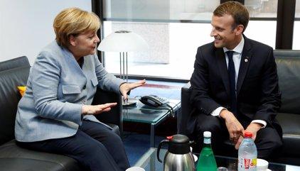 Merkel, Macron y otros líderes de la UE cierran filas con España ante el desafío independentista