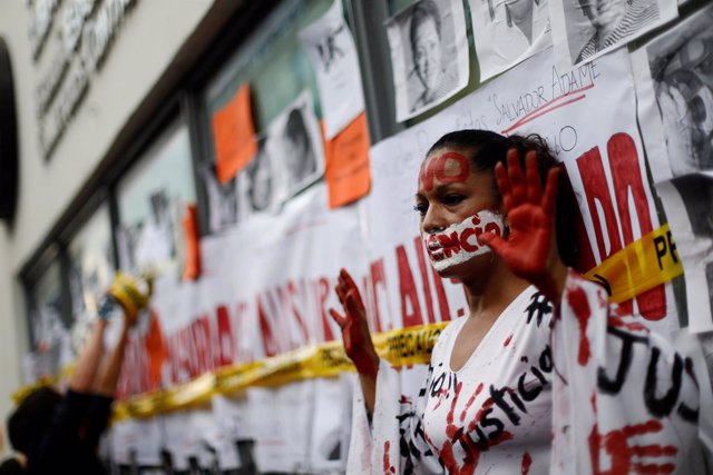 An activist takes part in a demonstration against the murder of journalists in M