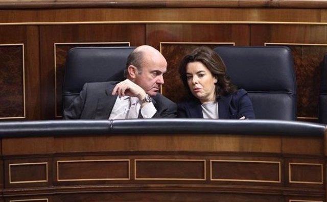Luis De Guindos y Soraya Sánez de Santamaría