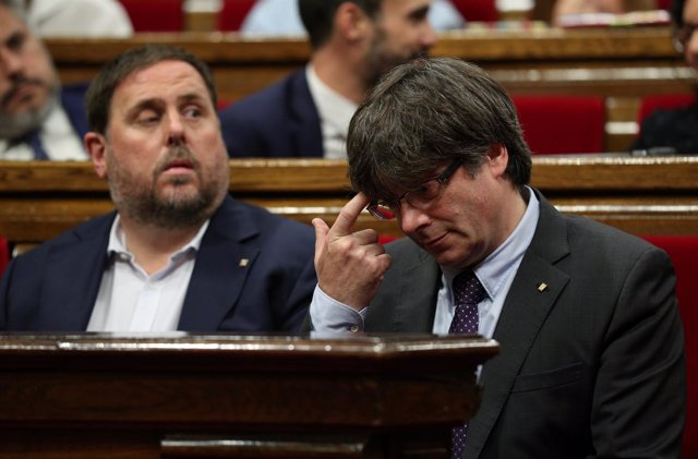 Carles Puigdemont y Junqueras
