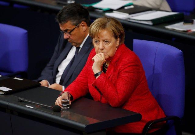 Sigmar Gabriel y Angela Merkel
