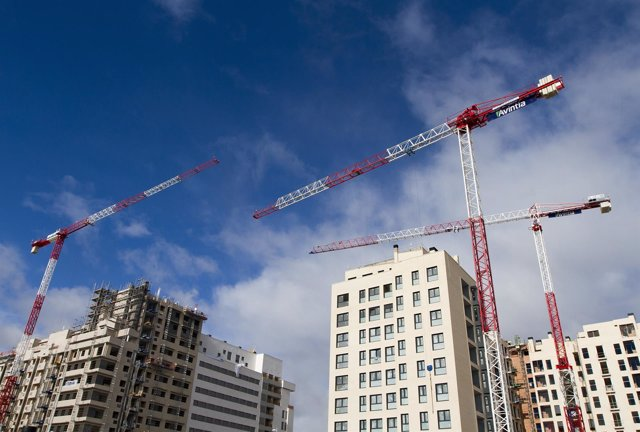 Cranes tower over apartment blocks under construction outside Madrid January 14,