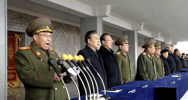 Ri Yong-Ho (L), Chief of General Staff of the Korea People's Army, speaks during