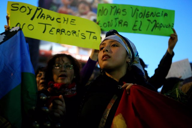 A Mapuche Indian activist attends a protest to demand justice for indigenous Map