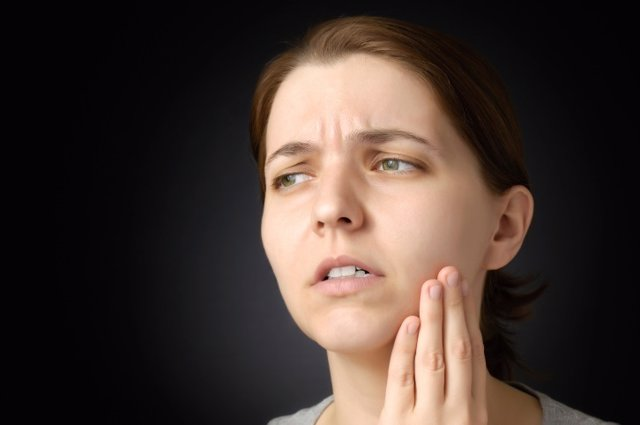 Dolor de muelas, mujer , flemón