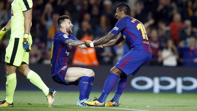 Paulinho y Messi con el Barcelona