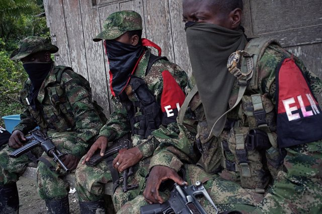 Rebels from Colombia's Marxist National Liberation Army (ELN) take a rest outsid