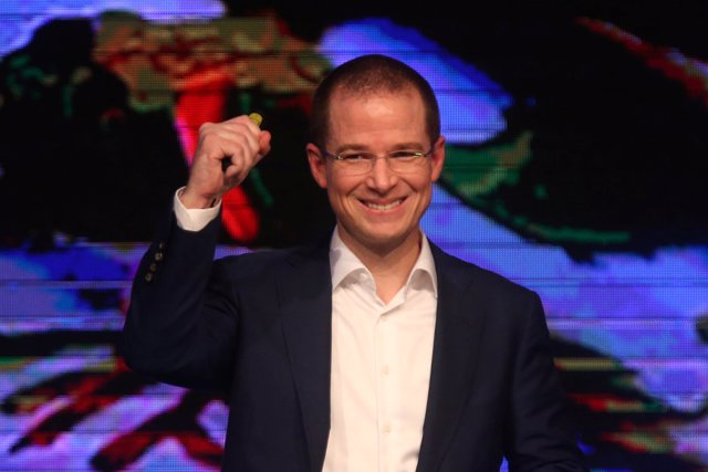 Ricardo Anaya gestures to his supporters after announcing his participation as a