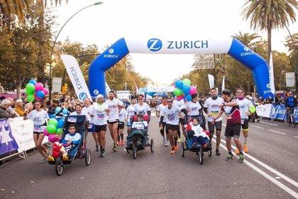Tres niños con ataxia telangiectasia, 'finishers' con su equipo en el Zurich Maratón de Málaga