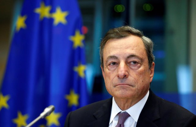 European Central Bank (ECB) President Mario Draghi waits to address the European