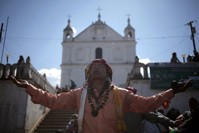 Carlos Tun, a Mayan priest, prays and participates in the pre-Hispanic mass of ""
