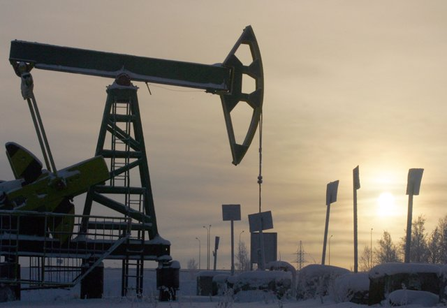 Yukos oil well is seen at sunset near the Russian northern city of Nefteyugansk.