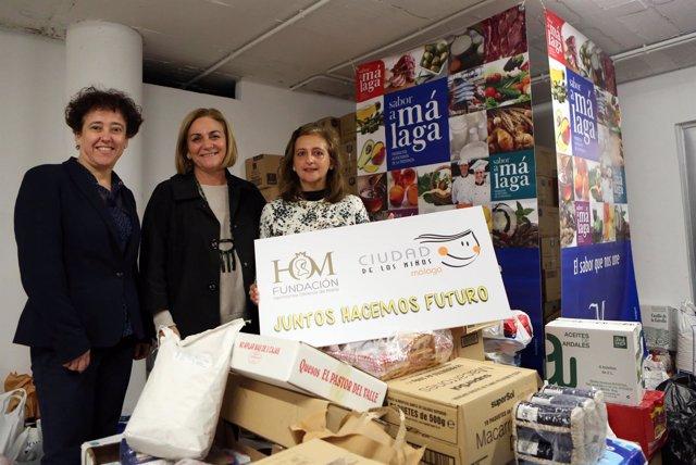 Entrega lotes productos primera necesidad Sabor a Málaga