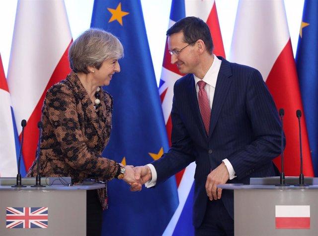 Theresa May y Mateusz Morawiecki