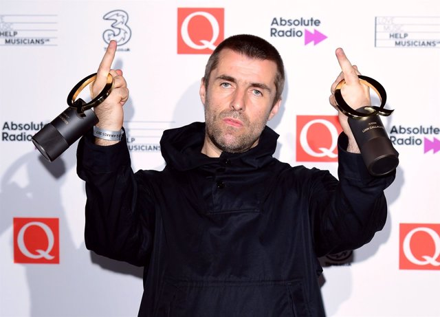 Liam Gallagher poses with his Best Live Act and Q Icon Awards during the Q Award