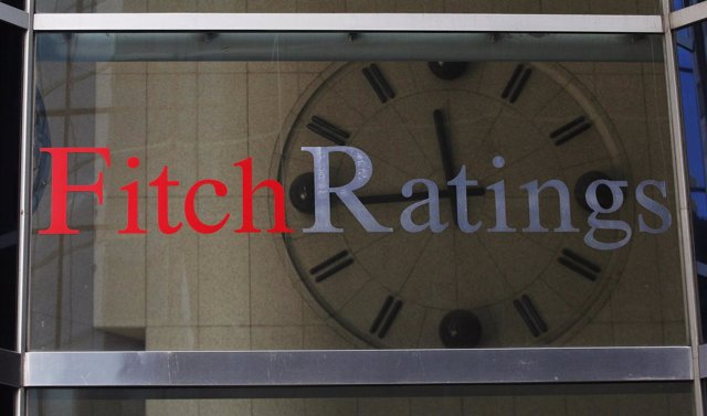 A clock is seen inside the lobby of the headquarters of Fitch Ratings.