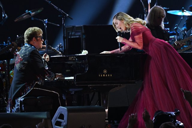 "Jan 28, 2018; New York, NY, USA; Elton John and Miley Cyrus perform ""Tiny Dancer"