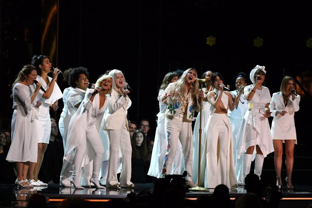 "Jan 28, 2018; New York, NY, USA; Kesha performs ""Praying"" with Cyndi Lauper, Cam"