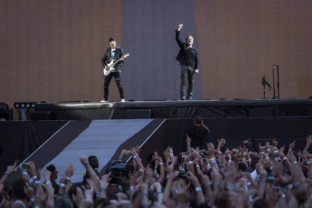 The Edge and Bono of U2 perform Joshua Tree live on stage at Twickenham Stadium,