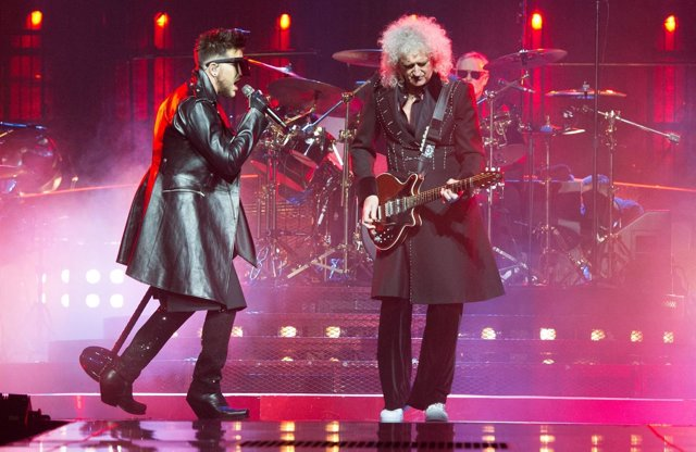 Adam Lambert with Brian May and Roger Taylor of Queen live on stage at Arena Bir