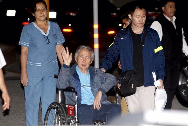 FILE PHOTO:Former Peruvian President Alberto Fujimori accompanied by his son Ken