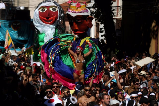 "Revellers take part in the annual block party known as ""Carmelitas"", during carn"