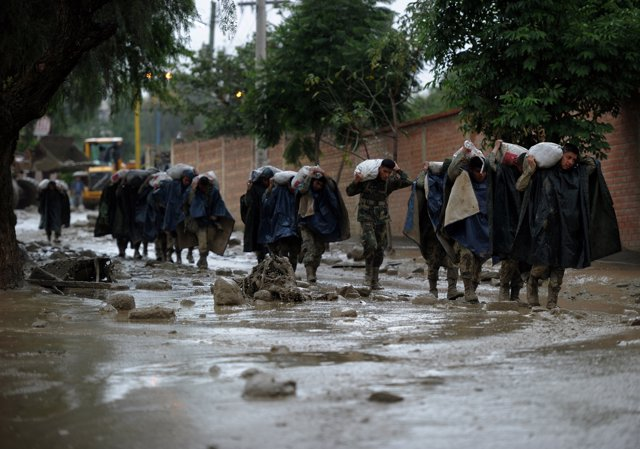 Soldier carry bags of sand during floods due to heavy rains, in Tiquipaya, Cocha