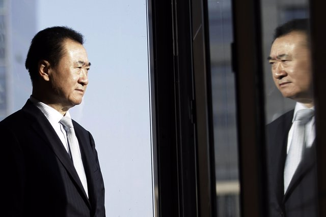 Wang Jianlin, chairman of Dalian Wanda Group, poses for a photo during an interv