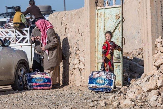 Familia de desplazados regresa a su casa en Irak
