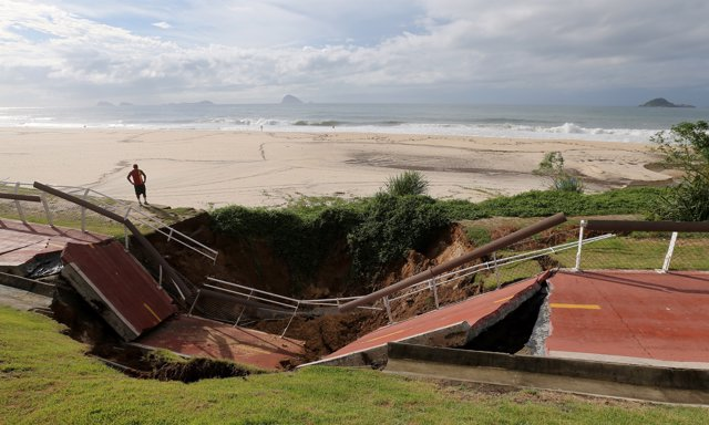 The collapsed area of a cycle lane is seen on Sao Conrado beach after heavy rain