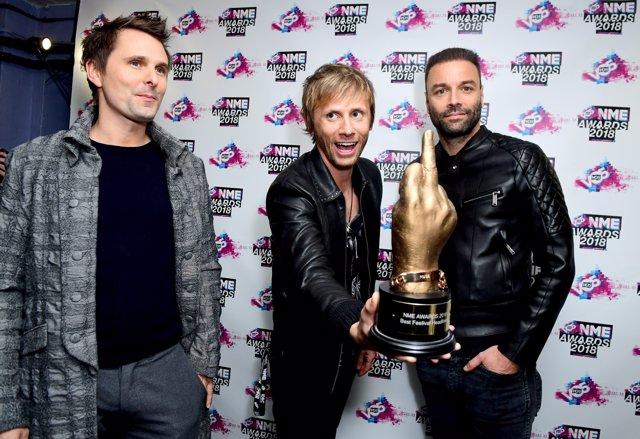 Matt Bellamy, Chris Wolstenholme and Dominic Howard of Muse holding the award fo