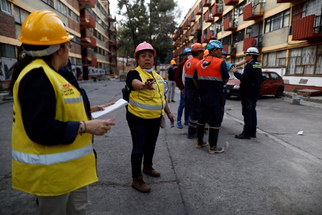 People react after an earthquake shook buildings in Mexico City, Mexico February