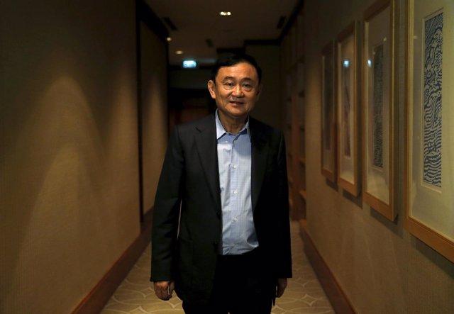 Former Thai Prime Minister Thaksin Shinawatra leaves after an interview with Reu