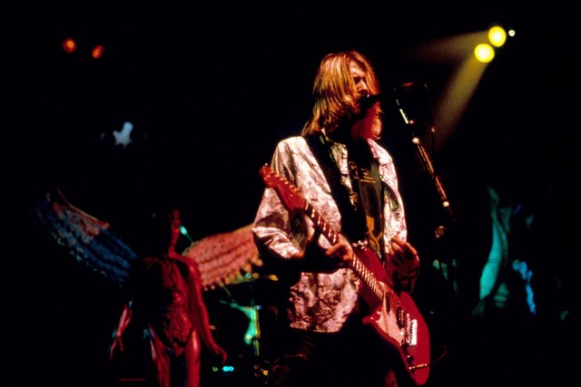Nirvana frontman Kurt Cobain performing on stage at the MTV Live and Loud concer