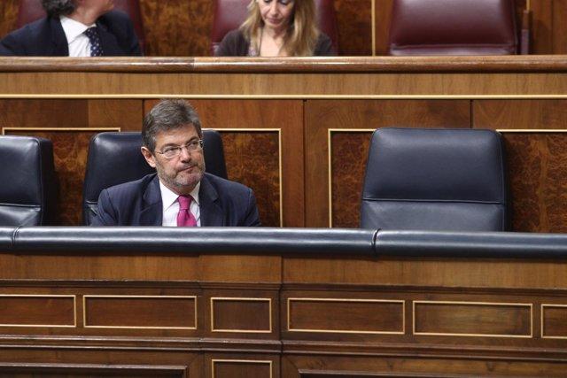 El ministro Rafael Catalá sentado en su escaño en el Congreso