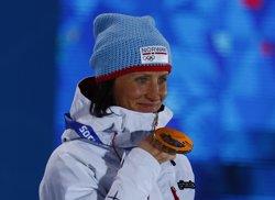 Marit Bjoergen entra en la història de l'olimpisme (SHAMIL ZHUMATOV / REUTERS)