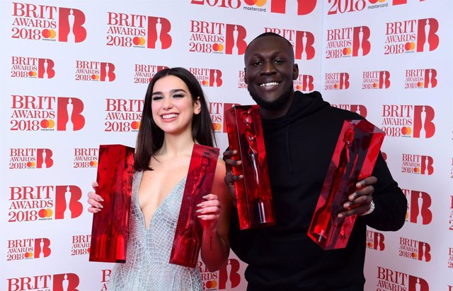Dua Lipa with her awards for Best British Female Solo Artist and Breakthrough Ac