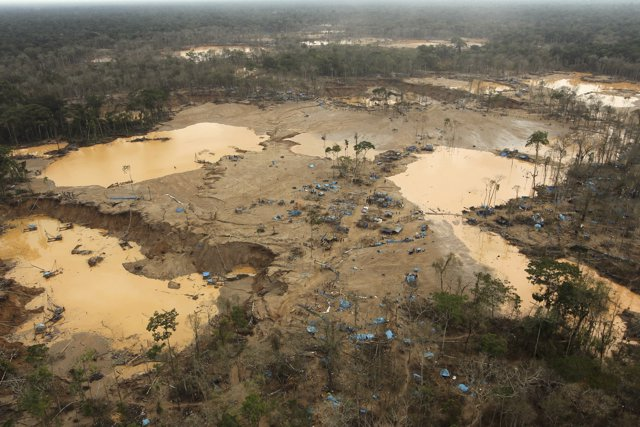 An area deforested by illegal gold mining is seen in a zone known as Mega 13, at