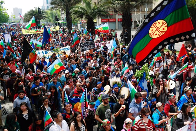 Mapuche Indian nad other activists take part in a rally against Columbus Day in