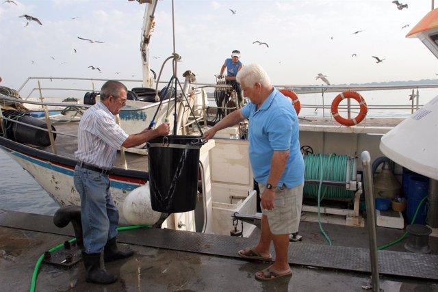 Imagen de pescadores andaluces