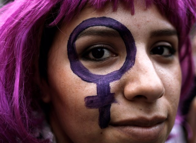 A demonstrator takes part in a march on International Women's Day in Sao Paulo,