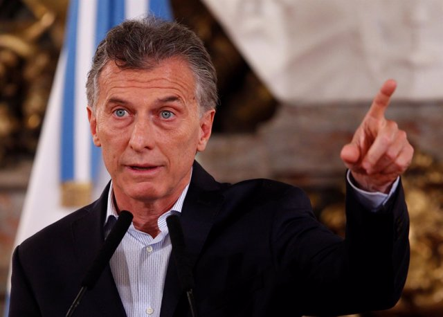 Argentina's President Mauricio Macri gestures during a news conference at the Ca