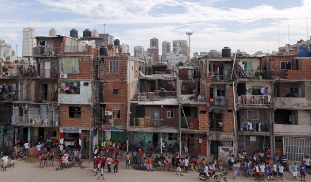 Residents are seen in the Villa 31 slum, which censuses show has grown 50 percen