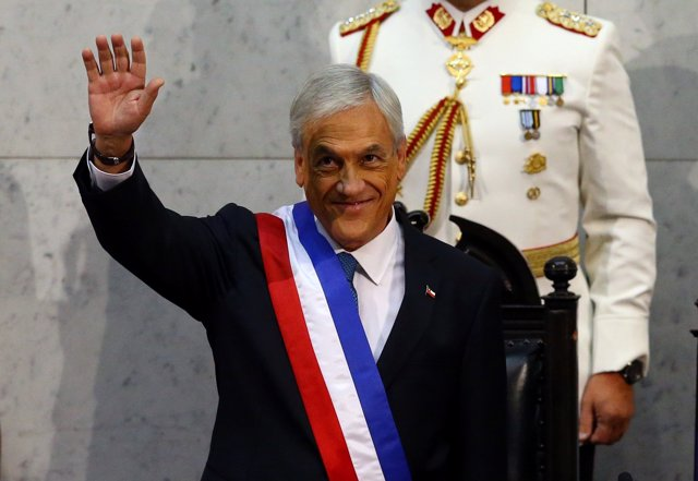 Chile's President Sebastian Pinera waves after being sworn in at the Congress in